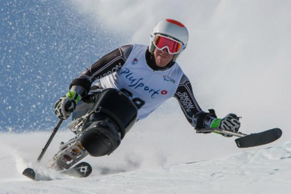 NZ Paralympian Corey Peters competing in an adaptive ski race